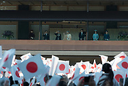 Well-wishers wave a Japanese national flag as Japan's Emperor Akihito (not pictured) appears on a balcony of the Imperial Palace to celebrate his 84th birthday in Tokyo, Japan, December 23, 2017. 23/12/2017-Tokyo, JAPAN