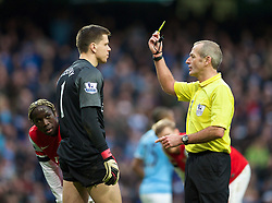 14.12.2013, Etihad Stadium, Manchester, ENG, Premier League, Manchester City vs FC Arsenal, 16. Runde, im Bild Arsenal's goalkeeper Wojciech Szczesny is shown, yellow card bt referee Martin Atkinson after, penalty is awarded to Manchester City // during the English Premier League 16th round match between Manchester City and Arsenal FC at the Etihad Stadium in Manchester, Great Britain on 2013/12/14. EXPA Pictures © 2013, PhotoCredit: EXPA/ Propagandaphoto/ David Rawcliffe<br /> <br /> *****ATTENTION - OUT of ENG, GBR*****