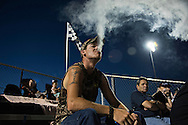 OCALA, FL - MAY 14, 2016:  <br /> <br /> Patrick Dowden of Homosassa, Fla. watches the action on the track as he vapes in the grandstand at the Bubba Raceway Park in Ocala, Fla. &quot;It's my first time here,&quot; said Dowden. &quot;I like NASCAR so I thought I'd come check it out.&quot;<br /> <br /> (Melissa Lyttle for the New York Times)