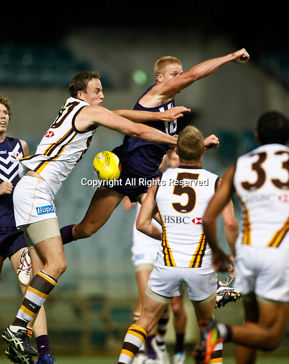 16.03.2012 Subiaco, Australia. Fremantle versus Hawthorn. Adam McPhee spoils the pack during the NAB Australian Rules  Cup game played at the Patersons Stadium.