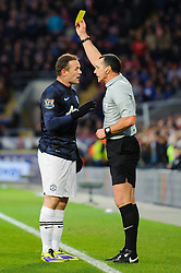 Man Utd Forward Wayne Rooney (ENG) is shown a yellow card during the first half of the match - Photo mandatory by-line: Rogan Thomson/JMP - Tel: Mobile: 07966 386802 - 24/11/2013 - SPORT - FOOTBALL - Cardiff City Stadium - Cardiff City v Manchester United - Barclays Premier League.