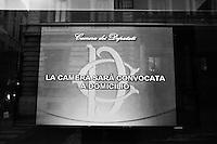 """ROME, ITALY - 24 JANUARY 2013: A screen with a message saying """"The Chamber (of Deputies) will be called at home"""" is seen at the entrance of the Library of the Chamber of Deputies in Rome on January 25, 2013. The Chamber of Deputies was dissolved by the President of the Republic Giorgio Napolitano after PM Mario Monti resigned in December 2012.<br /> <br /> A general election to determine the 630 members of the Chamber of Deputies and the 315 elective members of the Senate, the two houses of the Italian parliament, will take place on 24–25 February 2013. The main candidates running for Prime Minister are Pierluigi Bersani (leader of the centre-left coalition """"Italy. Common Good""""), former PM Mario Monti (leader of the centrist coalition """"With Monti for Italy"""") and former PM Silvio Berlusconi (leader of the centre-right coalition).<br /> <br /> ###<br /> <br /> ROMA, ITALIA - 24 GENNAIO 2013: Uno schermo riporta la dicitura """"La Camera sarà convocata a domicilio"""" all'entrata della Libreria della Camera dei Deputati a Roma,  il 25 gennaio 2013. Le camere sono state sciolte dal Presidente della Repubblica Giorgio Napolitano dopo che il premier Mario Monti ha rassegnato le proprie dimissioni a dicembre 2012.<br /> <br /> Le elezioni politiche italiane del 2013 per il rinnovo dei due rami del Parlamento italiano – la Camera dei deputati e il Senato della Repubblica – si terranno domenica 24 e lunedì 25 febbraio 2013 a seguito dello scioglimento anticipato delle Camere avvenuto il 22 dicembre 2012, quattro mesi prima della conclusione naturale della XVI Legislatura. I principali candidate per la Presidenza del Consiglio sono Pierluigi Bersani (leader della coalizione di centro-sinistra """"Italia. Bene Comune""""), il premier uscente Mario Monti (leader della coalizione di centro """"Con Monti per l'Italia"""") e l'ex-premier Silvio Berlusconi (leader della coalizione di centro-destra)."""