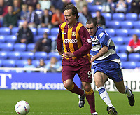 © Peter Spurrier/Sportsbeat Images <br /><br />04/10/2003 - Photo  Peter Spurrier<br />2003/04 Nationwide Football Div 1 Reading Town FC v Bradford City FC.<br />Bradfords Nicky Summerbee moves the ball away as Reading Andy Hughes moves in.