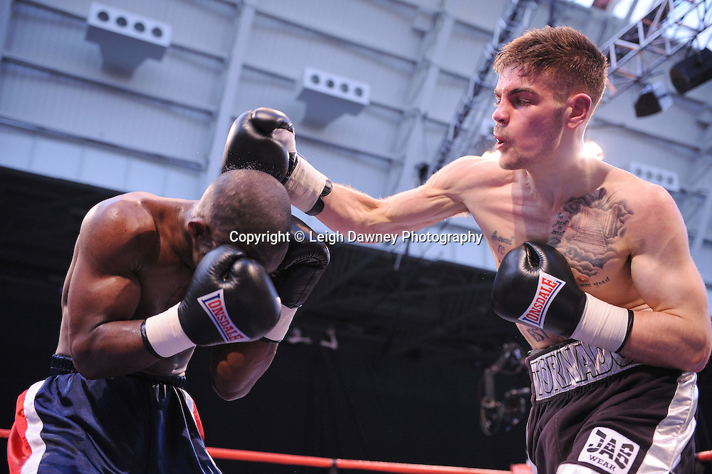 Tyler Goodjohn defeats Mark McKray (blue shorts) at London's Olympia on Saturday 30th April 2011. Matchroom Sport. Photo credit © Leigh Dawney.