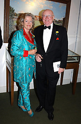 SIR BILL & LADY COTTON at the Natwest Summer of Cricket Auction Dinner in aid of Marie Curie Cancer Care held in The Long Room, Lord's Cricket Ground, London on 8th July 2004.