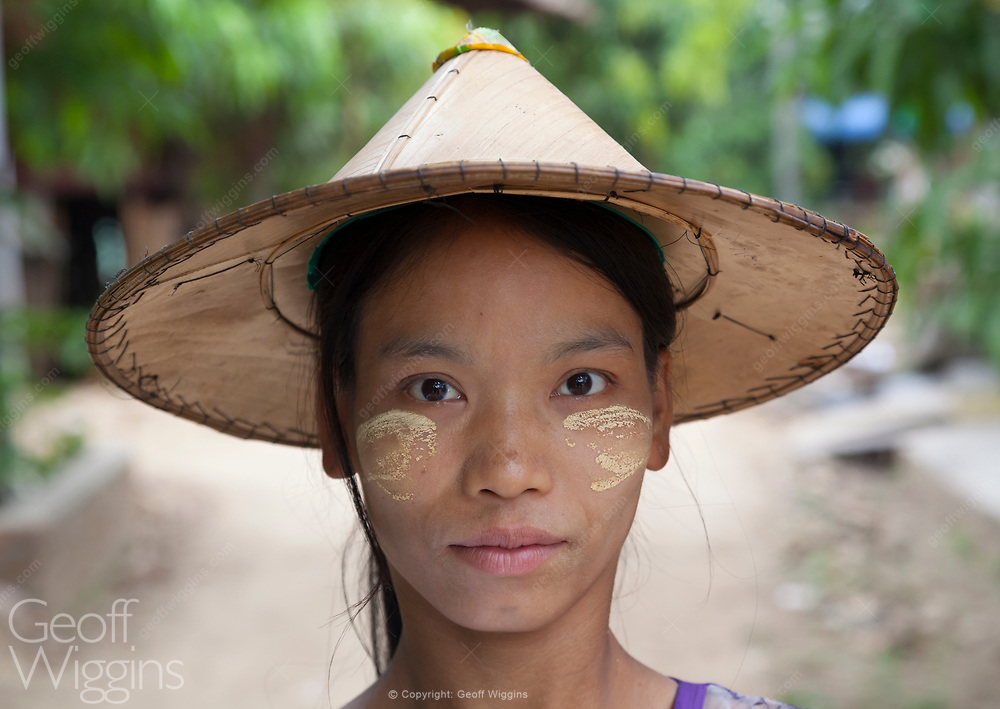 Village girl wearing thanakha, a yellowish-white cosmetic paste made from ground bark. It is a distinctive feature of the culture of Myanmar. Bilugyun, Mon State, Myanmar.