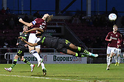 Northampton Town defender Charlie Goode (5) back heads the ball under pressure from a flying Forest Green Rovers midfielder Ebou Adams (14) during the EFL Sky Bet League 2 match between Northampton Town and Forest Green Rovers at the PTS Academy Stadium, Northampton, England on 14 December 2019.