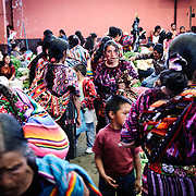 People buying and selling fresh produce at the Chichi market. Chichicastenango is an indigenous Maya town in the Guatemalan highlands about 90 miles northwest of Guatemala City and at an elevation of nearly 6,500 feet. It is most famous for its markets on Sundays and Thursdays.
