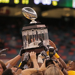 21 December 2008: Southern Miss players gather to hold up the New Orleans Bowl trophy following a 30-27 overtime victory by the Southern Mississippi Golden Eagles over the Troy Trojans in the  R+L Carriers New Orleans Bowl at the New Orleans Superdome in New Orleans, LA.
