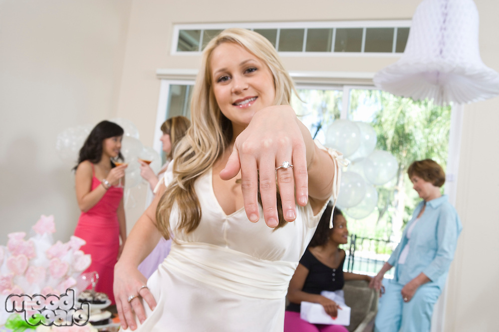 Young woman showing engagement ring