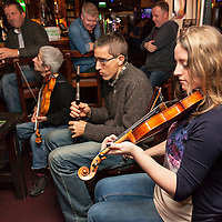 Traditional musicians playing a session in O'Hallorans Pub during the Ennis Trad Festival, 2014