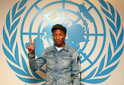 "Pharrell Williams is pictured at the United Nations on the United Nations ""International Day of Happiness"", Friday, March 20, 2015 in New York. Williams, in a partnership with the United Nations and the United Nations Foundation, was joined by 1,700 students in the UN General Assembly Hall where they learned how to take climate action in support of efforts including the Live Earth network of events.  Pharrell's efforts today included a digital activation with Google, inviting people to join a Global Happy Party for #HappyDay and #HappyPlanet. (Photo by Stuart Ramson/Invision for the United Nations Foundation/AP Images)"