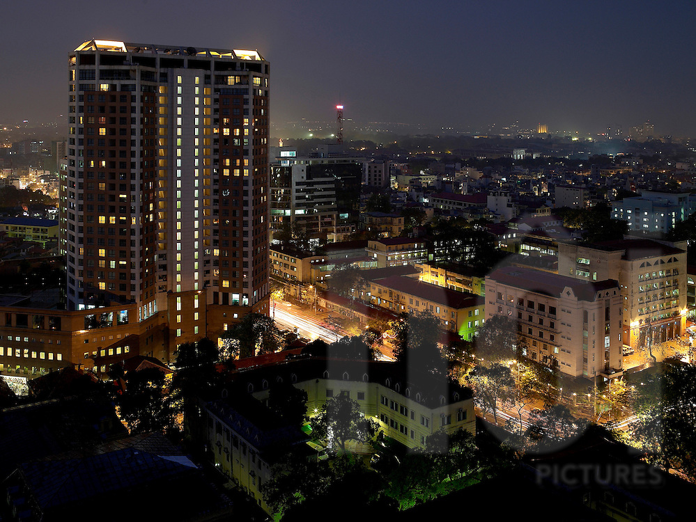Cityscape of Hanoi. View of Hanoi tower from melia hotel in the evening. buildings are floodlit, street are filled with lights of traffic jam. Density of construction in this concrete urban environment is high. Hanoi, Vietnam, Asia