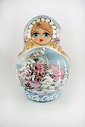 Wooden Russian Babushka Doll on white background