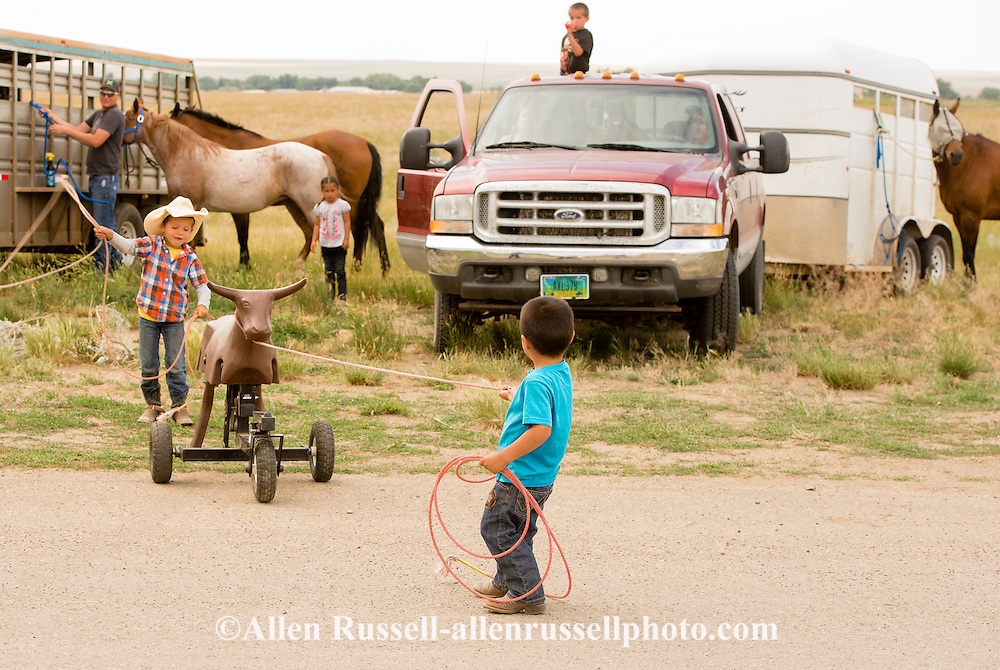 Rocky Boy Rodeo, Indians, families, horses, Rocky Boy Reservation, Montana, Charlie Ereaux, Gro Ventre, keeps an eye on his family kids