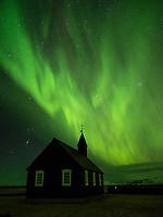 Northern Lights over Búðakirkja black church at Búðir, Snæfellsnes Peninsula, West Iceland.
