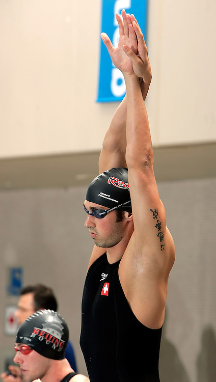 John HERZIG of Switzerland stretches before competing in the men's 100m freestyle final in the Hallenbad Oerlikon at the Swimming Swiss Championships in Zurich, Switzerland, Saturday 12 May 2007. (Photo by Patrick B. Kraemer / MAGICPBK)