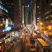 Des Voeux Road in Central Hong Kong with night time traffic shot at long exposure. 7 million people live on 1,104km square, making it Hong Kong the most vertical city in the world.