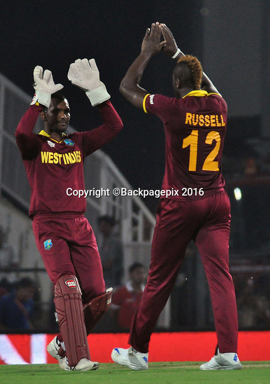 Johnson Charles and Andre Russell of West Indies celebrating during the 2016 ICC World T20 cricket match between South Africa and West Indies at Vidharbha Cricket Association, Jamtha, India on 25 March 2016 ©BackpagePix