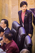 """09 JANUARY 2105 - BANGKOK, THAILAND: YINGLUCK SHINAWATRA, former Prime Minister of Thailand, walks to her seat during her impeachment trial in the National Legislative Assembly. Thailand's military-appointed National Legislative Assembly began impeachment hearings Friday against former Prime Minister Yingluck Shinawatra. If she is convicted, she could be forced to stay out of politics for five years. During her defense, Yingluck questioned the necessity of her impeachment, saying, """"I was removed from office, the equivalent of being impeached, three times already, I have no position left to be impeached from."""" A decision on her impeachment is expected by the end of January.    PHOTO BY JACK KURTZ"""