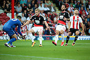 Nottingham Forest defender Damien Perquis (27)  shielding the ball from Brentford forward Scott Hogan (9)  during the EFL Sky Bet Championship match between Brentford and Nottingham Forest at Griffin Park, London, England on 16 August 2016. Photo by Matthew Redman.