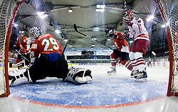 HETÉNYI Zoltan of Hungary and MALASINSKI Tomasz of Poland at IIHF Ice-hockey World Championships Division I Group B match between National teams of Hungary and Poland, on April 18, 2010, in Tivoli hall, Ljubljana, Slovenia. Hungary defeated Poland 6-0. (Photo by Vid Ponikvar / Sportida)