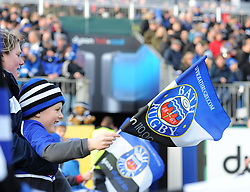A young flag bearer waits for the teams to emerge from the tunnel at the Recreation Ground - Photo mandatory by-line: Paul Knight/JMP - Mobile: 07966 386802 - 10/01/2015 - SPORT - Rugby - Bath - The Recreation Ground - Bath Rugby v Wasps - Aviva Premiership