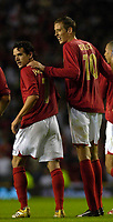 Photo: Daniel Hambury.<br />England v Greece. International Friendly. 16/08/2006.<br />England's Peter Crouch (R) and Owen Hargreaves.