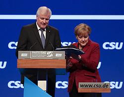 """20.11.2015, Messe Muenchen, Muenchen, GER, CSU Parteitag 2015, Festakt """"70 Jahre CSU"""", im Bild Bundeskanzlerin Dr. Angela Merkel nimmt ihr Redemanuskript vom Rednerpult vor der Rede von Ministerpraesident Horst Seehofer, // during ceremony """"70 years CSU"""" of CSU party convention in 2015 at the Messe Muenchen in Muenchen, Germany on 2015/11/20. EXPA Pictures © 2015, PhotoCredit: EXPA/ Eibner-Pressefoto/ Krieger<br /> <br /> *****ATTENTION - OUT of GER*****"""