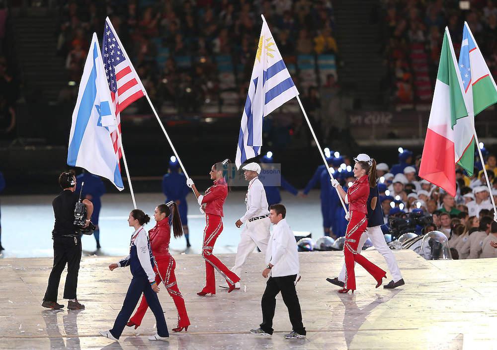 The athletes enter the stadium with the flags during Closing Ceremonies during day 16 of the London Olympic Games in London, England, United Kingdom on August 12, 2012..(Jed Jacobsohn/for The New York Times)..