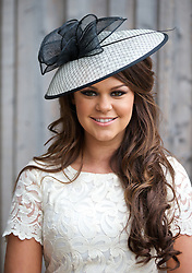 LIVERPOOL, ENGLAND - Friday, April 4, 2014: Claire Hughes from Liverpool wearing a Marks and Spencer hat during Ladies' Day on Day Two of the Aintree Grand National Festival at Aintree Racecourse. (Pic by David Rawcliffe/Propaganda)