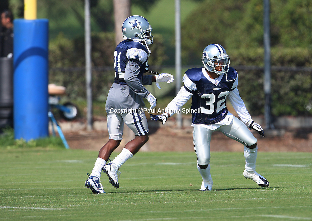 OXNARD, CA - JULY 26:  Cornerback Adam Jones #21 of the Dallas Cowboys goes out for a pass while covered by rookie cornerback Orlando Scandrick #32 of the Cowboys during a pass defense drill during the 2008 Dallas Cowboys Training Camp at River Ridge Field in Oxnard, California on July 26, 2008. ©Paul Anthony Spinelli *** Local Caption *** Adam Jones;Orlando Scandrick