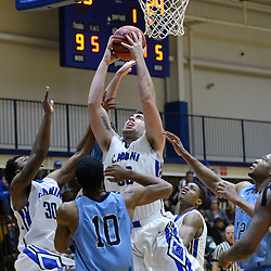 DAILY TIMES - TOM KELLY IV<br /> Cabrini's Sean Mayo (50) pulls in a rebound during the Immaculata at Cabrini men's basketball game on Wednesday, January 7, 2014.
