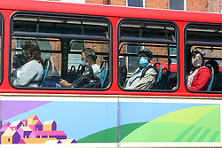 © Licensed to London News Pictures. 15/06/2020. London, UK. Commuters wearing face coverings travel on a bus in north London. Face covering is now compulsory on buses, trains, trams and planes. Secretary of State for Transport, Grant Shapps has said that, people who do not wear face covering on public transport from today could be fined up to £100. Photo credit: Dinendra Haria/LNP