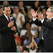 Mel Watt, left, and G.K. Butterfield prepare the crowd for an appearance by Barack Obama during a rally for the Presidential candidate Thursday at Minges Coliseum. (Jason A. Frizzelle)