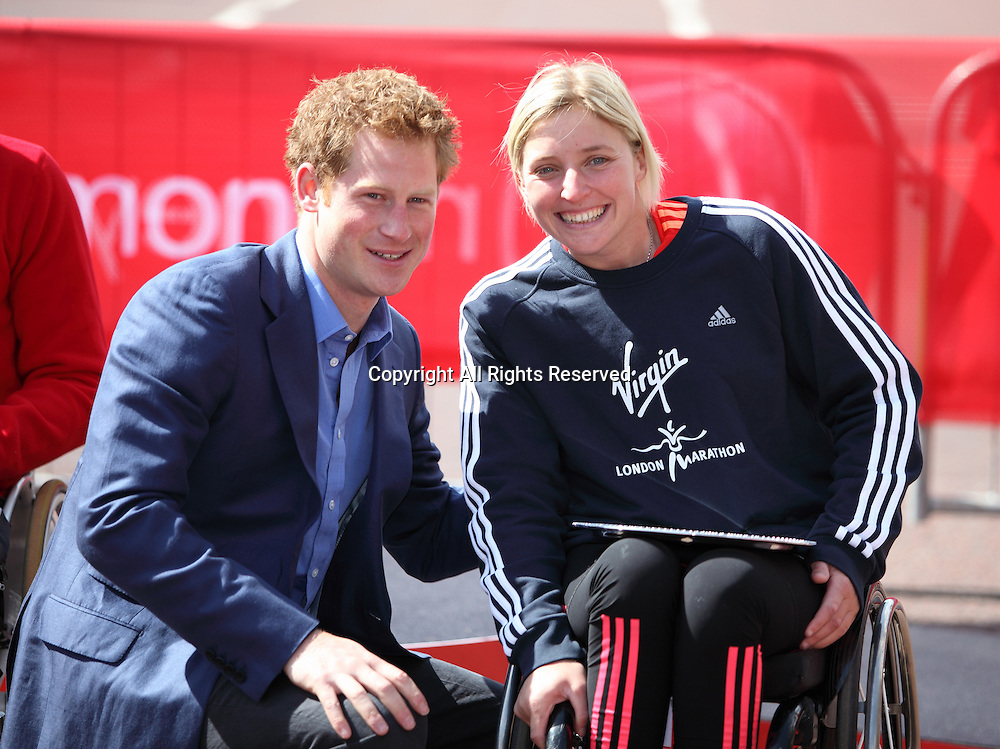 22.04.2012 London, England. Prince Harry poses with the winner of the 2012 Virgin London Wheelchair Marathon Shelly Woods (Great Britain & NI).