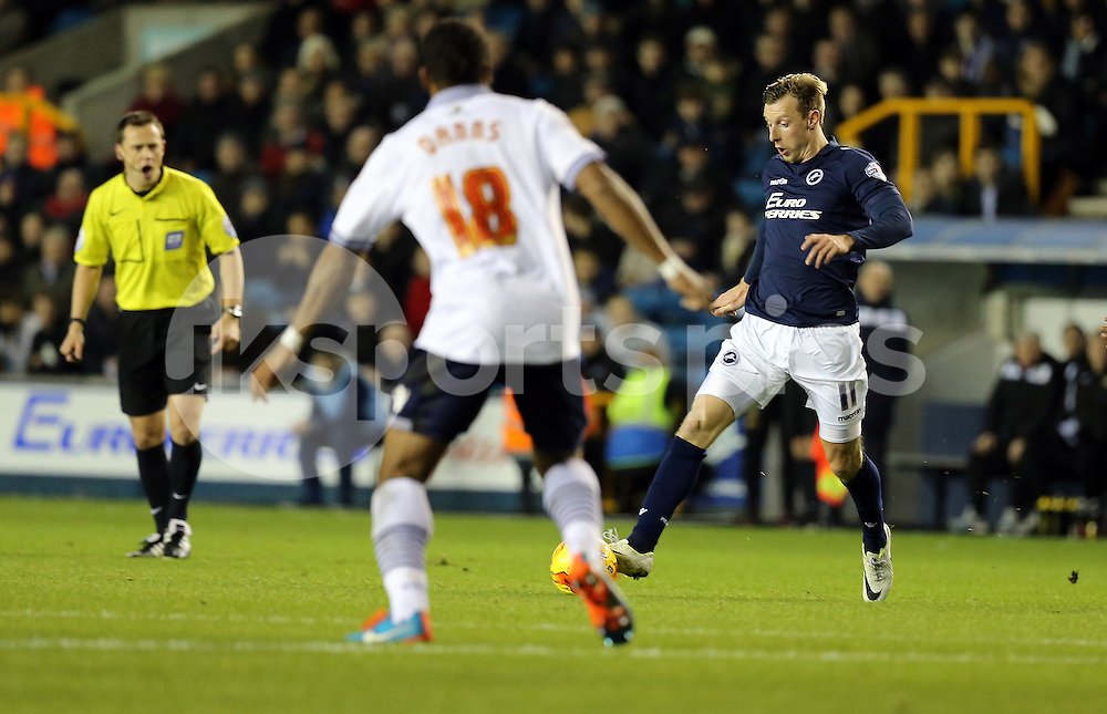 Martyn Woolford takes on Neil Danns of Bolton Wanderers during the Sky Bet Championship match between Millwall and Bolton Wanderers at The Den, London, England on 19 December 2014. Photo by Dave Peters.