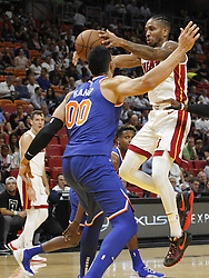 October 24, 2018 - Miami, FL, USA - The Miami Heat's Rodney McGruder, right, passes the ball over the head of the New York Knicks' Enes Kanter (00) in the first half on Wednesday, Oct. 24, 2018, at the American Airlines Arena in Miami. The Heat won, 110-88. (Credit Image: © Carl Juste/Miami Herald/TNS via ZUMA Wire)