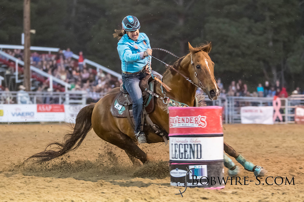 Stacy Smallwood makes her run in the barrel racing during the second performance of the Elizabeth Stampede on Saturday, June 2, 2018.