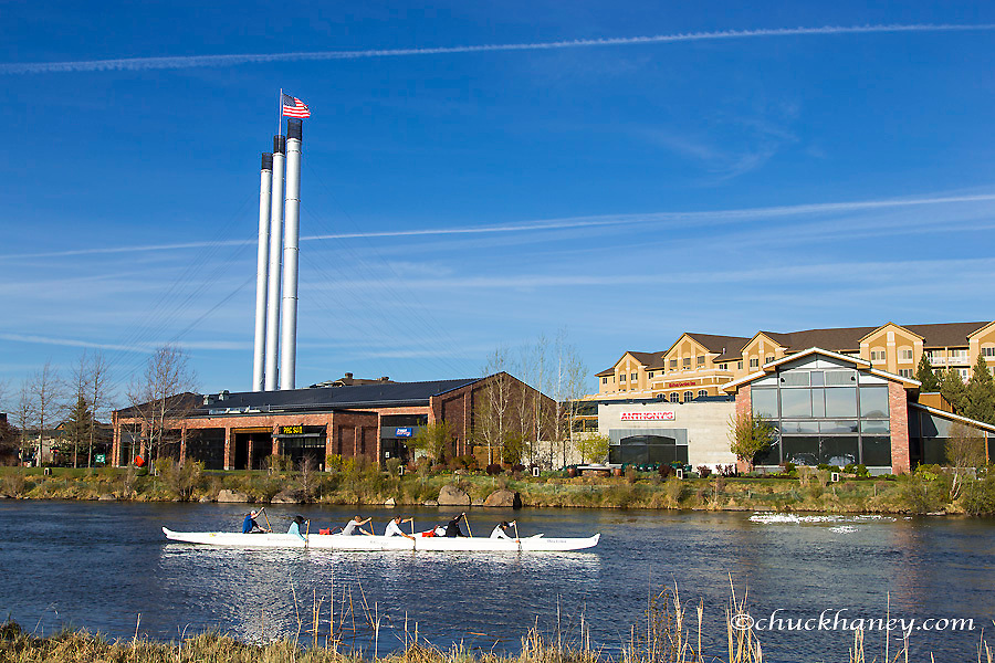 Paddlers on the Deschutes River in the Old Mill District of Bend, Oregon, USA