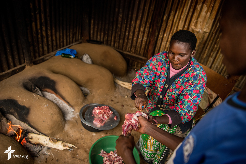 A staff member slices meat for dinner in the U-Dom ELCK (Evangelical Lutheran Church in Kenya) Project 24 kitchen on Wednesday, June 22, 2016, in Chepareria, Kenya.  LCMS Communications/Erik M. Lunsford