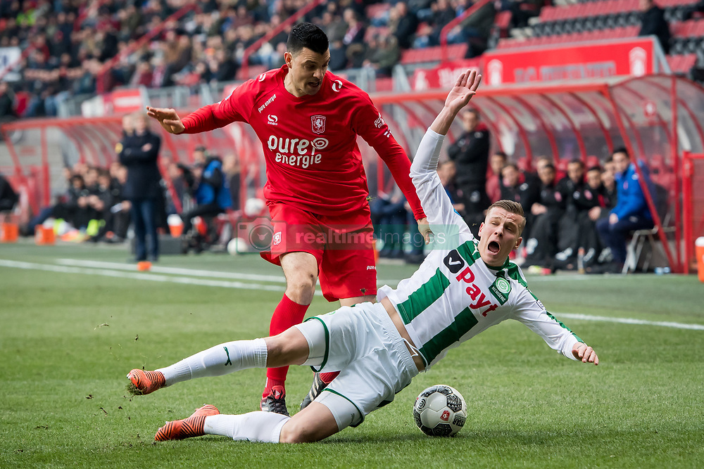 (L-R) Haris Vuckic of FC Twente, Samir Memisevic of FC Groningen during the Dutch Eredivisie match between FC Twente Enschede and FC Groningen at the Grolsch Veste on March 04, 2018 in Enschede, The Netherlands