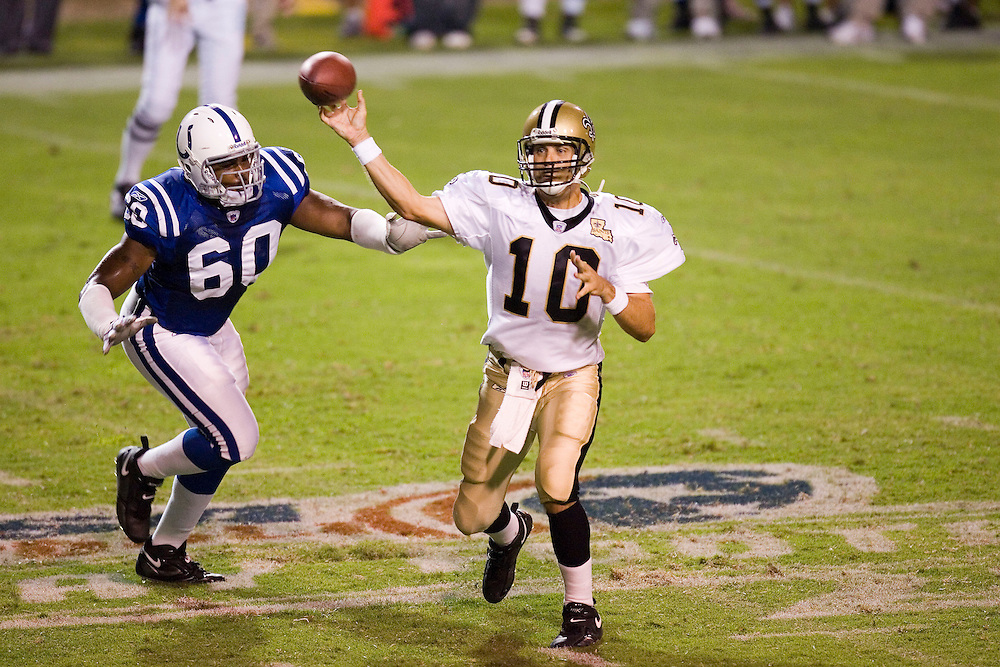 JACKSON, MS - AUGUST 26:  Quarterback Jamie Martin of the New Orleans Saints throws a pass while being chased by defensive lineman Marcus West of the Indianapolis Colts on August 26, 2006 at Veterans Memorial Stadium in Jackson, Mississippi.  The Colts won 27 to 14.  (Photo by Wesley Hitt/Getty Images) *** Local Caption *** Jamie Martin