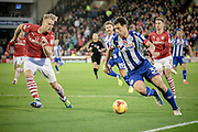 Yanic Wildschut (Wigan Athletic) runs into the Barnsley penalty box as Marc Roberts (Barnsley) tries to block him during the EFL Sky Bet Championship match between Barnsley and Wigan Athletic at Oakwell, Barnsley, England on 19 November 2016. Photo by Mark P Doherty.