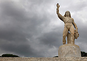 Statue at the Stadio dei Marmi or Stadium of the Marbles, a stadium designed c. 1928 by Enrico Del Debbio and inaugurated 1932, at the Foro Italico, Rome, Italy. The stadium has Carrara marble steps lined by 59 marble statues of athletes in classical style. The Foro Italico or Foro Mussolini is a sports complex built 1928-38 in Fascist style by Enrico Del Debbio and Luigi Moretti, inspired by Roman forums. Fascist architecture developed in the late 1920s and 1930s, as a modernist style in times of nationalism and totalitarianism under Benito Mussolini. It is characterised by large, square, symmetrical buildings with little or no decoration, often inspired by ancient Rome and designed to convey strength and power. Picture by Manuel Cohen