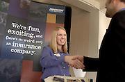 16275Career Fair Photos    .. Laura Pizom, Pricing Analyst, Progressive Insurance, From Cleveland Ohio greets senior Jeff Maas