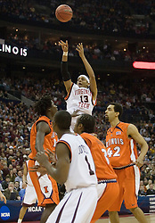 Virginia Tech Hokies forward Deron Washington (13) shoots the game winning shot against Illinois.  The #5 seed Virginia Tech Hokies defeated the #12 seed Illinois Illini 54-52 in the first round of the Men's NCAA Tournament in Columbus, OH on March 16, 2007.
