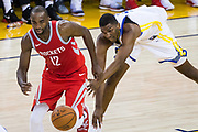 Golden State Warriors forward Kevon Looney (5) and Houston Rockets forward Luc Mbah a Moute (12) battle for a loose ball at Oracle Arena in Oakland, Calif., on October 17, 2017. (Stan Olszewski/Special to S.F. Examiner)