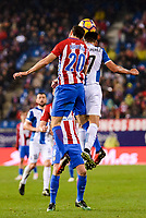 Atletico de Madrid's player Juanfran Torres and RCD Espanyol player Hernan Perez during match of La Liga between Atletico de Madrid and RCD Espanyol at Vicente Calderon Stadium in Madrid, Spain. December 03, 2016. (ALTERPHOTOS/BorjaB.Hojas)