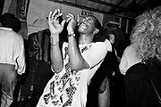 Man Playing the Air Trumpet in Club , London, 1990s.